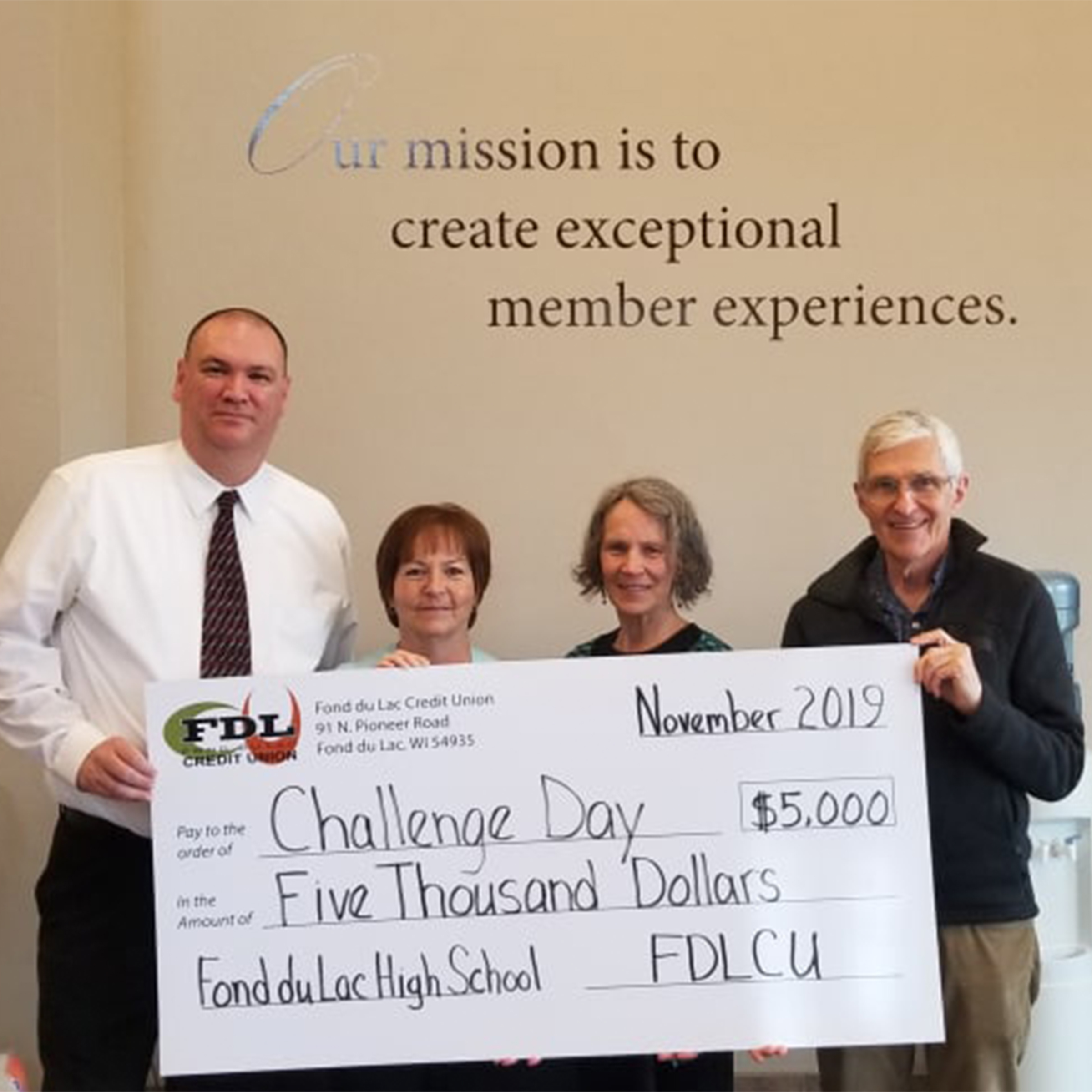 holding big check for Challenge Day