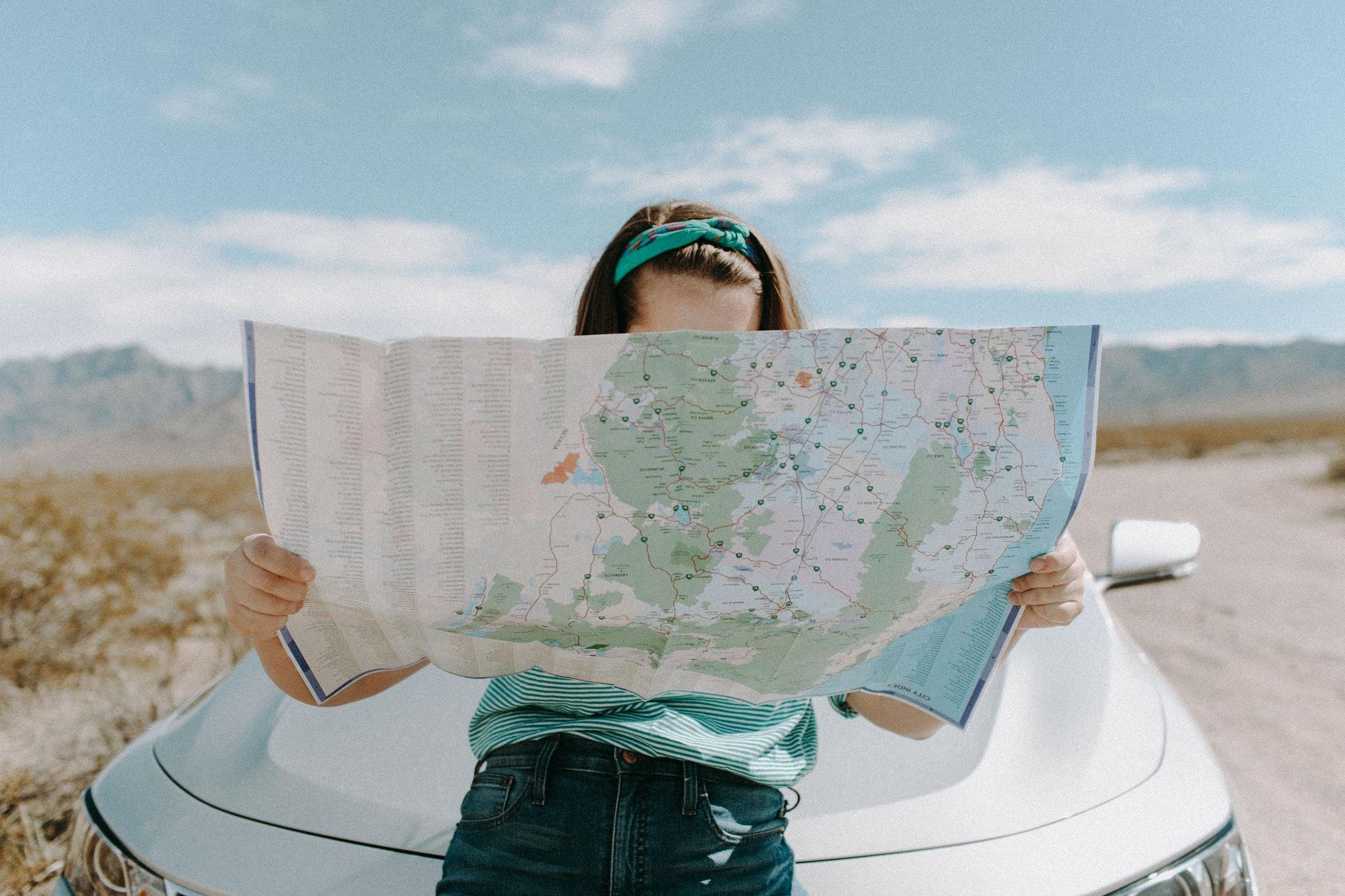 girl looking at road map