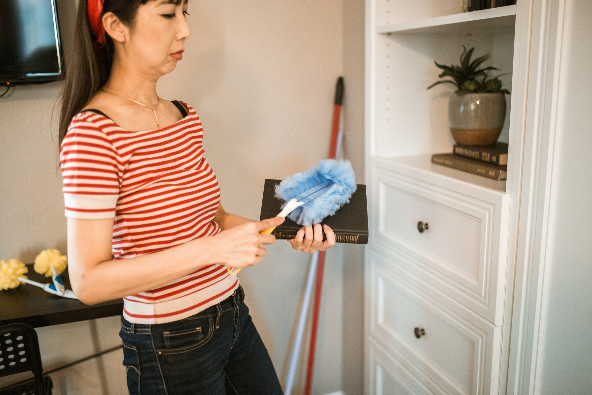 woman dusting book