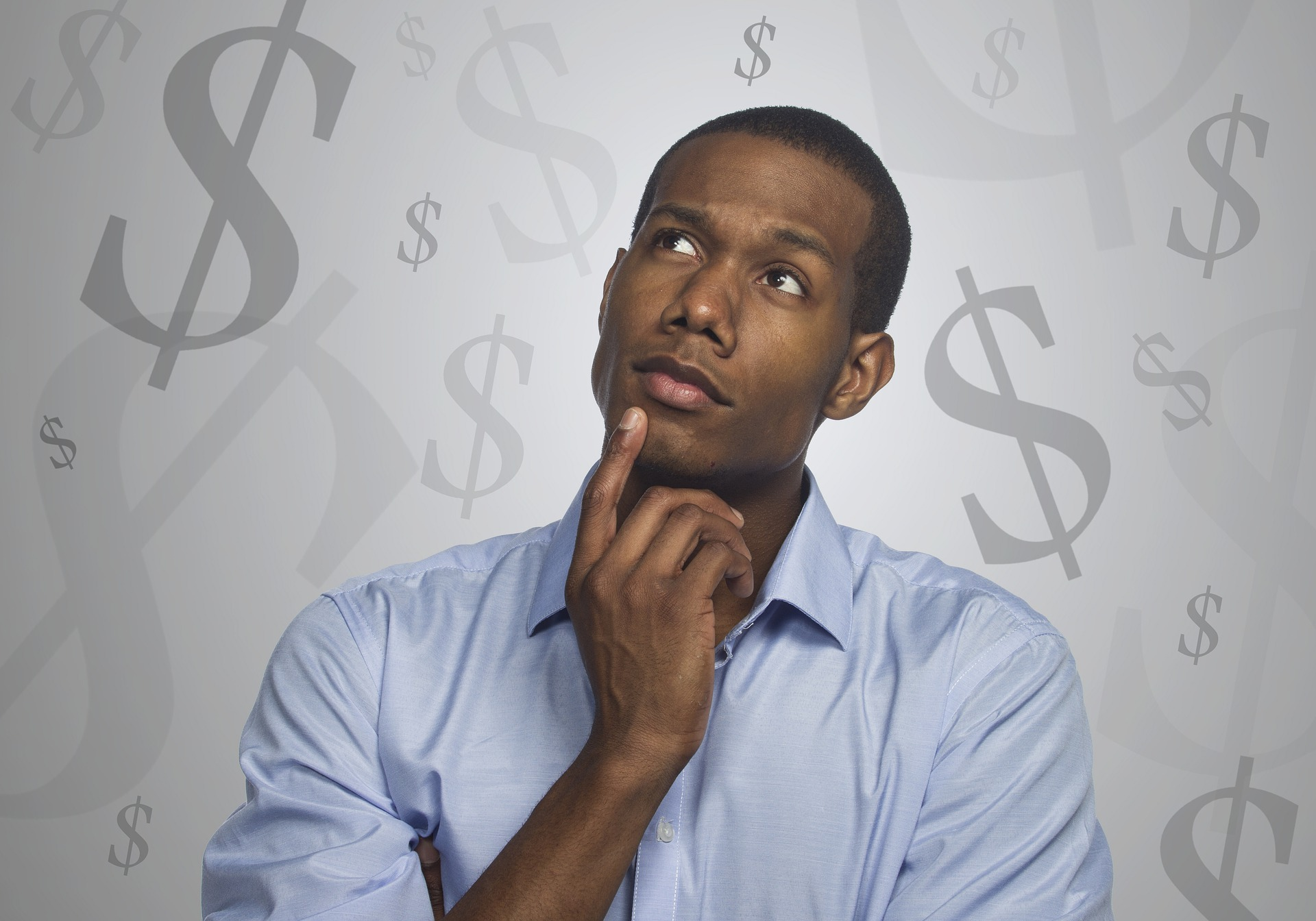 man thinking with dollar signs in the background
