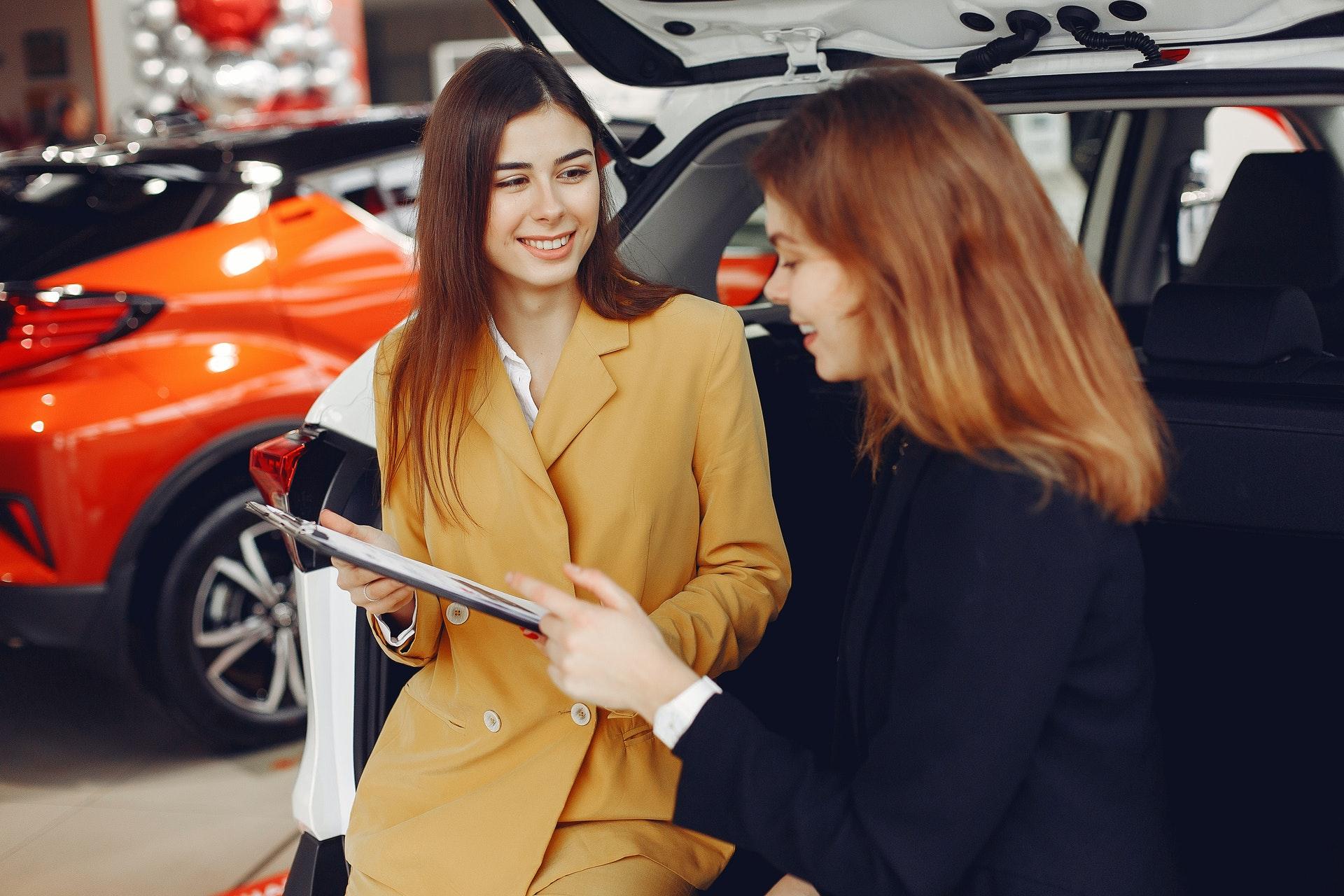 woman purchasing a car at a dealership