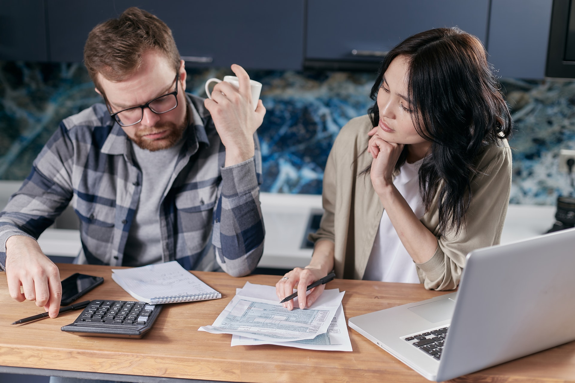 man and woman couple working on finances