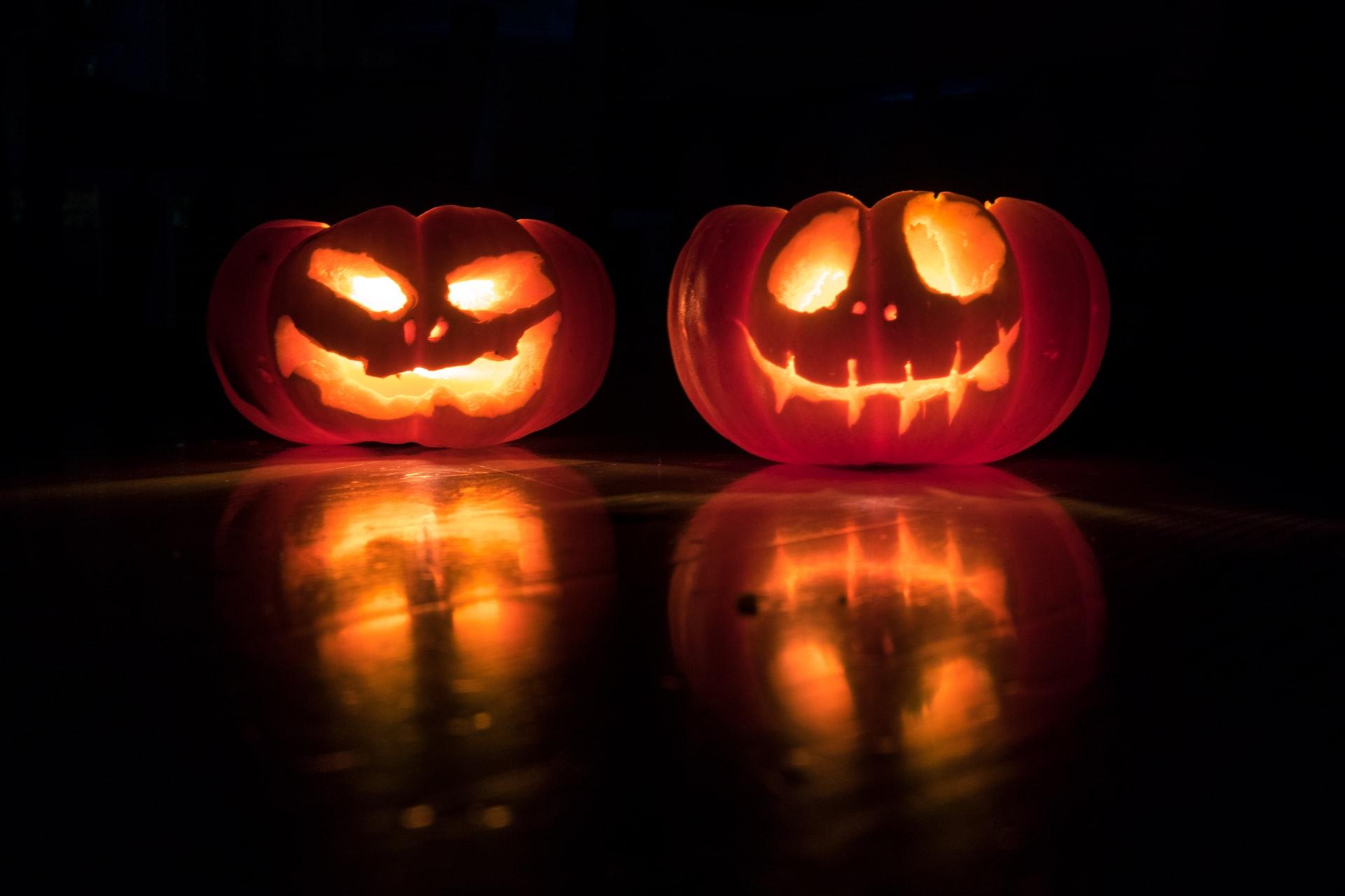 two lit jack-o-lanterns