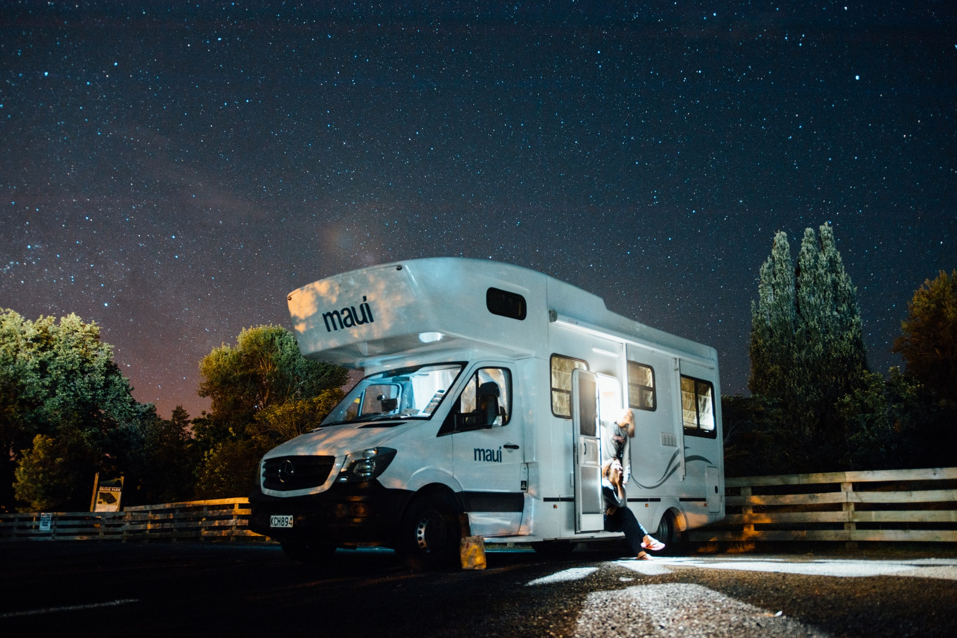 RV with a starry night sky backdrop